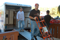 Kevin Zigenmeyer (front) and Kevin Burke (in rear) were among the workers who helped move the Auburn, CA, congregation back into its building after an extended absence. (photo courtesy Phil Sparling)