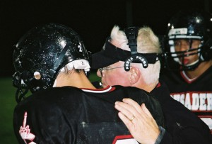Mike Stanley, right, a member of the Grace Brethren Church of Columbus, OH, since 1987 and a former high school coach, sold his interest in several Columbus-area McDonald's restaurants and in 1999 joined Crusade Football as head coach.