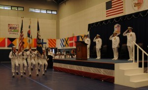 Navy Chaplain Lou Urban (far left on stage) participates in a Change of Command in Korea.