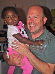 Dan O'Deens with Haitian child