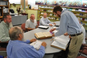 Eric Bradley, coordinator of the digitization project for the Brethren Digital Archives, measures a book to ensure that it meets requirements for scanning.