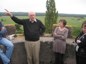 Tom Julien, the original purchaser and developer of the Chateau St. Albain, gave a tour and historical lecture to the gathered CHARIS leaders. Here he points out some of the surrounding sites from the parapets atop the tower, which is about 50 feet above ground on the south side of the facility. In the mountain range in the background, Mont Blanc can be seen when the weather conditions are clear. To the right of Julien is his daughter Becky Schwan, who was raised in the chateau and is now living with her husband, David, in England.