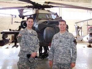 Grace Brethren Army Chaplain Capt. Pete Stone, right, is pictured in front of an Apache helicopter with fellow FGBC chaplain, Capt. John Jacobsen.