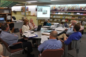 Lyrasis representative Laurie Gimmell (left, in white jacket) explains the digitization process to members of the Brethren Digital Archives committee.