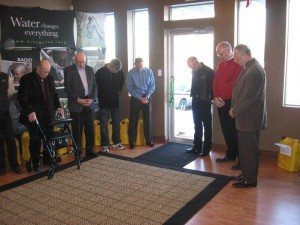 ICDI founder Jim Hocking (in doorway) and other staff, board members and friends participated in a ribbon-cutting dedicatory ceremony and Open House Sunday afternoon, February 13, of ICDI's new world headquarters building on State Road 15 north of Warsaw, Indiana.