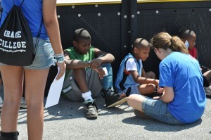 Students share the Gospel with children at a Johnstown skate park.
