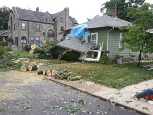 Today's storm blew a large tree onto the Fifth Street home of Joann Wilcoxson, doing damage to the front of the house. Tom Avey, Fellowship Coordinator, lives in the house to the left.