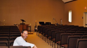 Pastor Doug Black in the newly-remodeled worship area.