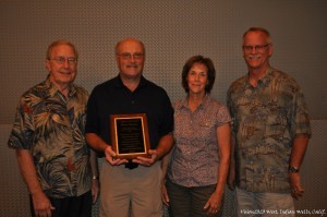 Bernie Simmons, long-time children's pastor at Grace Polaris in Columbus, Ohio, was recognized by the Association of Grace Brethren Ministers with Lifetime Achievement Award for his many years of faithfulness in that position.. He is pictured with his wife, Sue; Jim Custer, left, former senior pastor at the Columbus church, who made the presentation; and Joel Richards, president of AGBM
