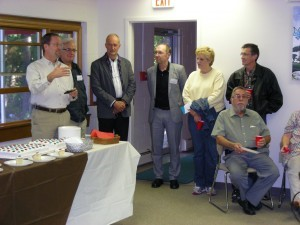 Dave Guiles, executive director of Encompass World Partners, makes comments during Sunday's open house.