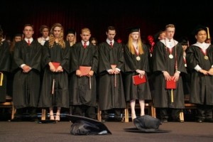 DAVID YAMAMOTO/SPECIAL TO THE STAR Members of the Class of 2013 close their eyes in prayer Friday after they are announced as graduates of Grace Brethren High School in Simi Valley.