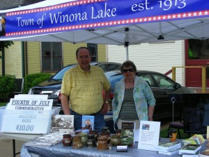 Terry White, author of the new BMH Books titled, Winona at 100: Third Wave Rising, and Gladys Deloe sell the book and other Winona Lake memorabilia at today's Art Festival in Winona Lake.