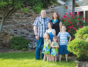 Goshen-area artist Andy Jewett is pictured with his family.