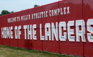 The red windscreens at the tennis courts at Grace's Millier Field feature strong Lancer branding to enhance the experience for fans, athletes and visitors.