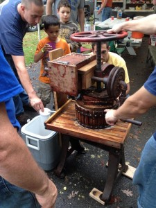 The boys learned to make apple cider at the recent Fall Outpost.