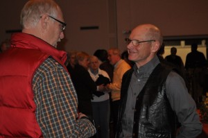 Jim Hocking, founder and executive director of Water for Good, talks with an audience member after Sunday night's program.