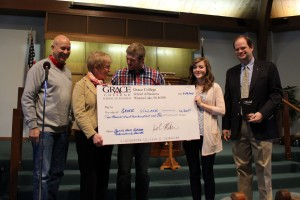 Students in the Grace College Entrepreneurship and Business Practicum class held an event at Grace Village and donated the proceeds of their business class project to Grace Village in the sum of $2,200. Pictured from left to right are Grace College President Bill Katip, Carol Buhlman, Jacob Mackin, Georgi Sandlin, and Dr. Jeff Fawcett.