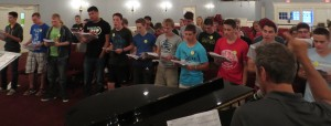 After some intense practicing, the OB choir gives an impressive run-through for the night.