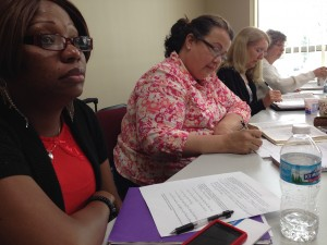 Emmanuella Alexis, Rosa Munoz, Dianne Bruckner, and Janet Minnix take notes during this week's Facilitator Training Class that will enable them to teach classes in the Women's Leadership