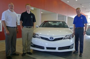 Nate Bosch (pictured in middle), director of the Center for Lakes and Streams at Grace College, Winona Lake, Ind., accepts grant from Toyota Motor Sales, U.S.A., Inc. with Gabe Douglas (picture on left), sales manager at Toyota of Warsaw, Ind., and John Rice (pictured on right), general manager at Toyota of Warsaw, Ind.