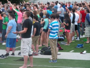 Momentum students gather in the McCulley Stadium on the Wheaton campus for a concert of prayer Friday evening.