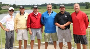 The winning group of the 2014 outing, pictured with Trent Barlow (left) and Chad Briscoe (right).