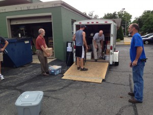 Steve Barrett directs the packing of the van that will carry supplies for the 2014 national conference of the Fellowship of Grace Brethren Churches.