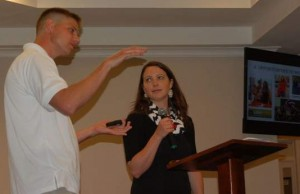 Capt. James D. Murray IV, left, speaks about his work as an Army chaplain at Grace Church of Aiken on Sunday. Murray is shown with his wife, Ashley, who also gave a brief talk during the presentation. (Aiken Standard photo)