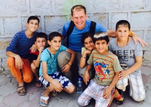 Pastor Jim Brown of Grace Community Church, Goshen, Ind., with Iraqi children.