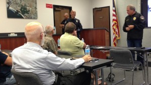 Police Chaplain Don Shoemaker, right, introduces