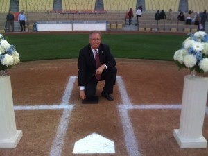 A wedding at Dodger Stadium in Los Angeles afforded Pastor Roy Halberg, who played the position of catcher on a variety of teams, an opportunity to pose at home plate.