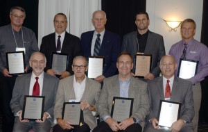 Shown are individual award recipients as well as representatives from companies, which were inducted into the KEDCo Hall of Fame in Warsaw, Ind., recently. Seated are Dr. Ron Manahan, Dr. Paul Grossnickle, Bill Henthorn, and Dr. Bill Katip, president Grace College. In back are Dan Robinson, Robinson Construction; Gary Gerard, Williams Family and TImes-Union; Chuck Yeager, Seymour Midwest, Josh Wildman and Brent Wildman. (Photo by Deb Patterson, inkfreenews.com)