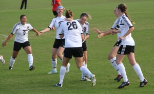 Mallory Rondeau (center) celebrates her first-minute goal on Wednesday with (left) Kaitlyn Hayes, Meredith Hollar, Meredith Matson, Holly Bennett, and Carianne Sobey as they played to a 3-0 victory over Mid-America Christian Wednesday at the NCCAA semifinals.