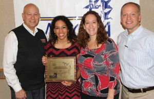 Pictured are (left) Grace president Dr. Bill Katip, Hannah Clemmons, Grace coach Andria Harshman, Grace athletic director Chad Briscoe at Wednesday's 2014 NCCAA National Volleyball Banquet.