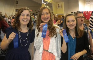 "Pictured are 6th grade Superior ribbon winners Joy Hanes, Avery Hobbs and Rachel Dempsey. Joy Hanes' speech ""The Joy of the Lord"" and Avery Hobbs' speech ""The Cornerstone of our Society"" were student-written original speeches. Rachel Dempsey's speech was entitled ""Temperance & Women's Rights."""