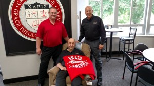 Dean Sandy (seated), who just retired with 44 years of service to Grace College, is photographed with college president, Dr. Bill Katip (right), and James Bloemendaal (left), general manager of Sodexo food service.