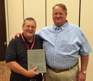 Kurt Miller, right, was recognized as Pastor of the Year at the Association of Grace Brethren Ministers meeting on Sunday. Jim Brown, right, presented the award.