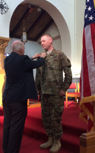 Col. Schumacher participates in the ceremony of Chaplain Jonas Winbolt to be promoted to captain.