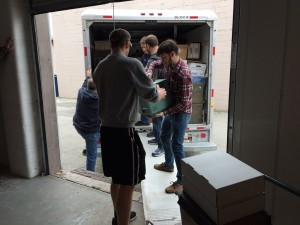 Grace College students and other volunteers help unload items from the former Grace Brethren North American Missions organization.